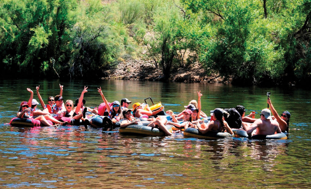 People tubing on river